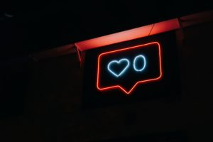 Neon sign in the shape of instagram likes