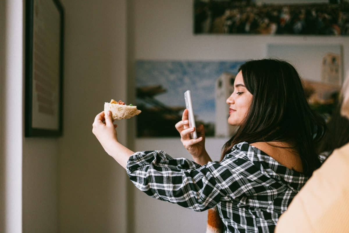 Find instagram influencers uk: woman taking photo of food